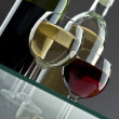 Wineglasses with two wine bottles — Foto Stock