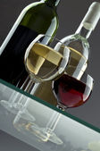 Wineglasses with two wine bottles — Stock Photo