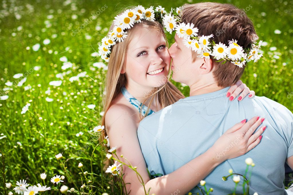 Pretty young couple in the fields  Stock Photo #5871975