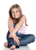 Cute happy little girl sitting on white background — Stock Photo