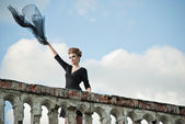 Young woman with flying fabric on terrace — Стоковое фото