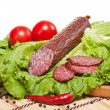 Salami with lettuce, garlic and tomatoes — Stock Photo