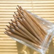 Pencils in a glass at the office - Stock Photo