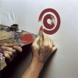 Artist painting a target - Stock Photo