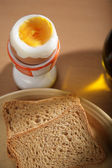 Breakfast with two pieces of toast bread and an egg — Stock Photo