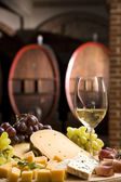 White wine in fine glass in front of an old blackboard — Stock Photo