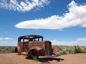 Ford Old Vintage Rusty along Route 66 United States Arizona Nevada sky blue — Stock Photo