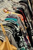 Dresses on the hangers in some shop — Stock Photo