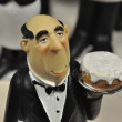 Statuette of the waiter on the shelf — Stock Photo