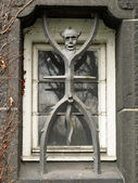 The devil as a window grate — Stock Photo