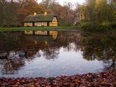 Yellow half timbered house at lake — Stock Photo
