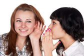 Two girls gossiping — Stock Photo