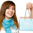 Royalty-Free Stock Photo: Surprised girl with blue shopping bag