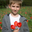 Boy with bouquet of tulips — Stock Photo #5966720