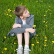 Boy on dandelion meadow — Stock Photo