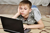 Little boy with laptop — Stock Photo