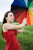 Girl with a colorful umbrella — Stock Photo