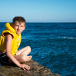 Boy in yellow life jacket — Stock Photo #6234370