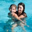 Smiling children in the swimming pool — Stock Photo