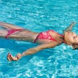 Young girl is swimming — Foto de stock #6234384