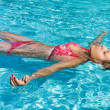 Young girl is swimming — Foto Stock #6234384