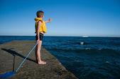 Boy on the pier waving — Foto Stock