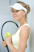 Girl with a tennis racket — Stock Photo