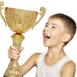 Little champion with his trophy — Stock Photo