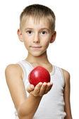 Chico guapo con manzana roja — Foto de Stock
