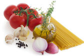 Pasta and ingredients on white — Stock Photo