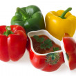 Red, green and yellow bell peppers with red ceramic ornament — Стоковая фотография