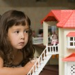 The girl with a small house for dolls — Stock Photo