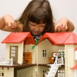 Girl and house for dolls — Stock Photo #5986340