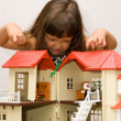 Girl and house for dolls — Stock Photo
