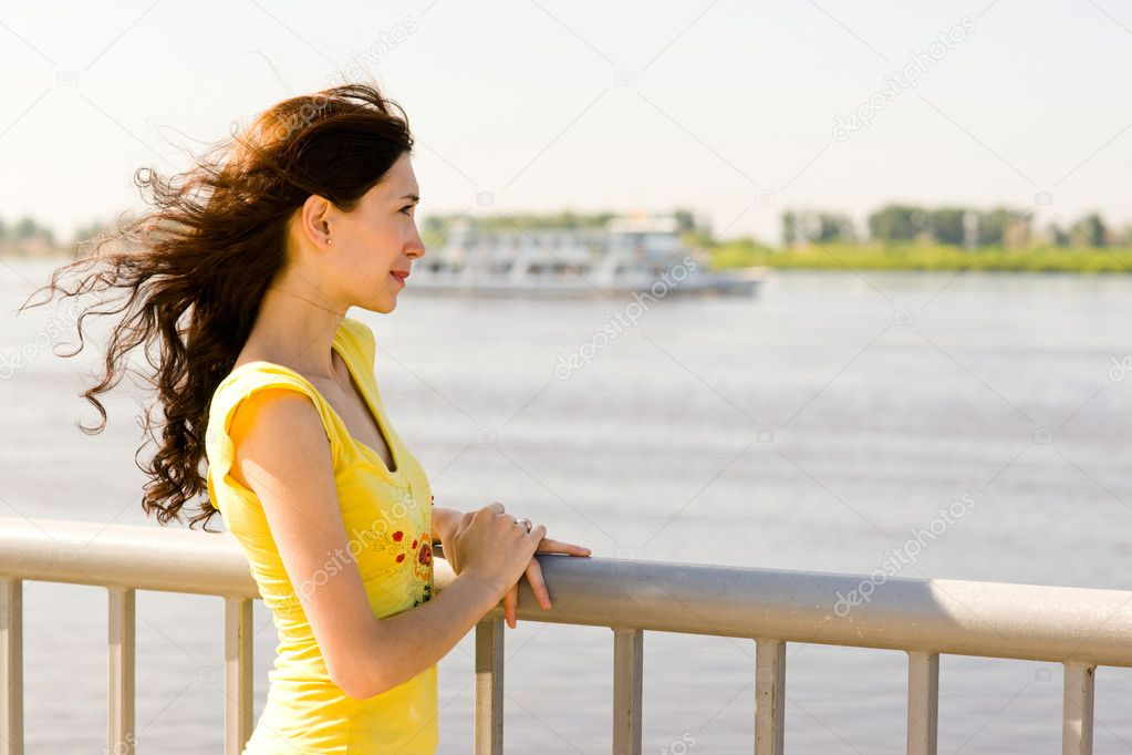 Woman near the river  a waiting ship — Stock Photo #6009517