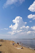 Summer beach with under white clouds — Stock Photo