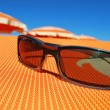 Sunglasses and beach — Foto Stock