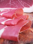 Sliced Parma ham, typical italian prosciutto — Stock Photo