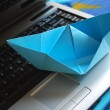 Paper boat sailing on laptop — Stock Photo #6007003