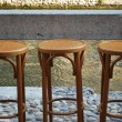 Three old bar stools — Stock Photo