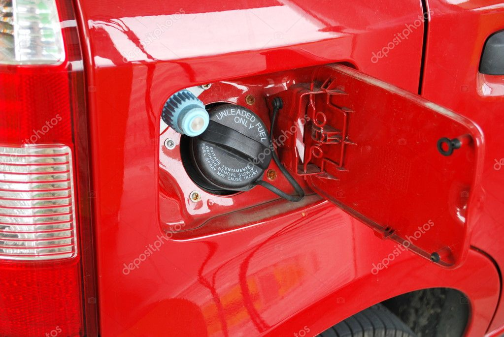 Ecologic methane red car fueling detail — Stock Photo #6009260