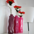 Gerbers  in three vases - Stock Photo