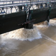 River flood and dam wall — Stock Photo