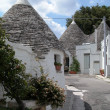Trulli houses in Alberobello - Stock Photo
