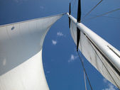 White sail against blue sky — Foto Stock