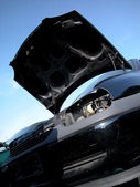 Old black car at junkyard — Stock Photo