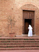 Nun enter in the church — Stock Photo