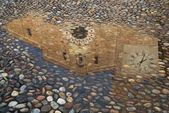 Reflection of a church in a puddle — Stock Photo