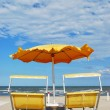Beach chairs and umbrella — Stock Photo