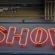 Neon shop sign — Stock Photo